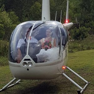 helicopter landing with bride inside