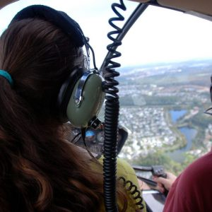 photo from behind helicopter pilot and trainee
