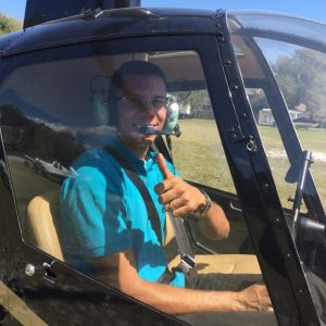 man giving thumbs up in helicopter