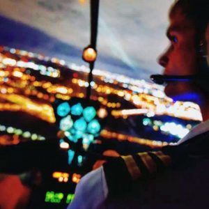 night photo of pilot in helicopter